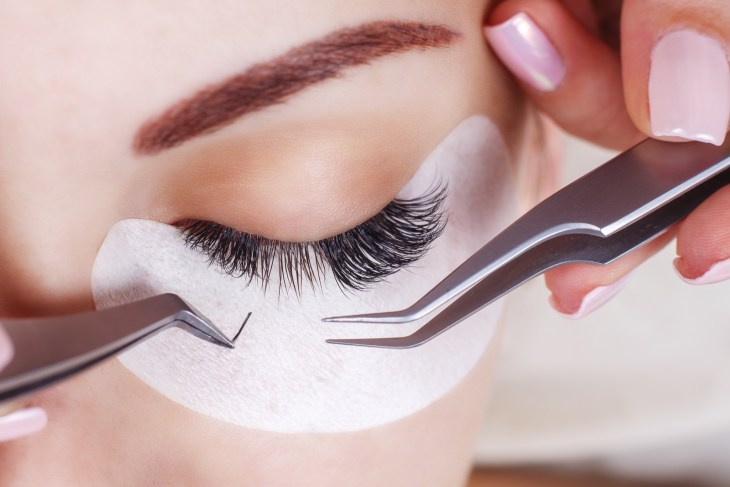 Woman getting lash extensions