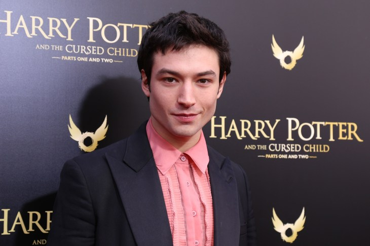 Ezra Miller at the opening for Harry Potter and the Cursed Child wearing a pink button up and black suit jacket