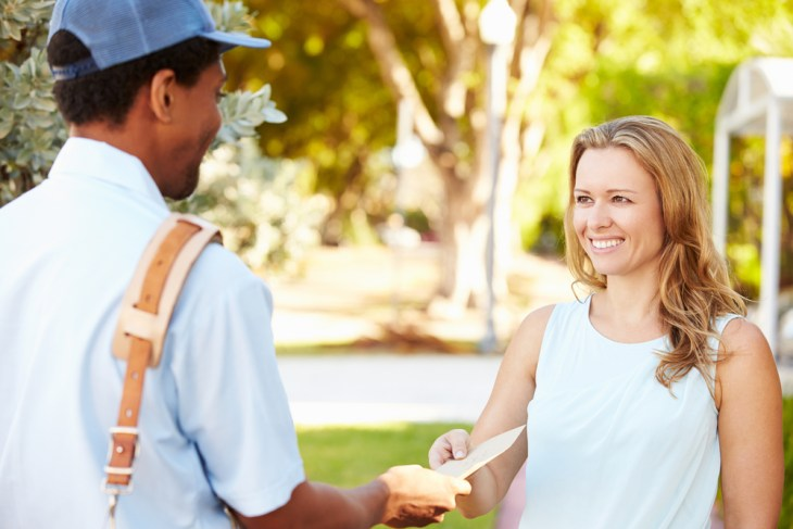 Mailman delivering mail to a woman