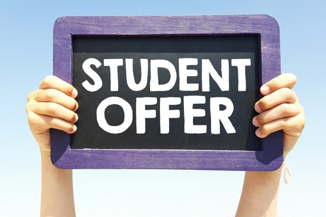 "A small black board with the words ""student offer"" on it"