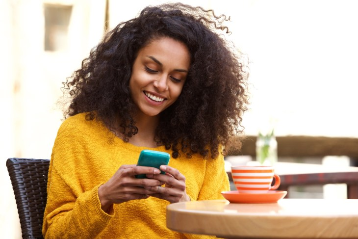 Woman texting and smiling