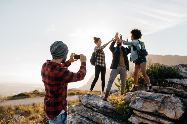 A group of friends hiking and taking a picture