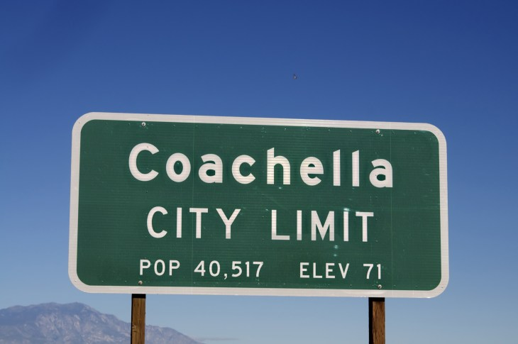Green exit sign on side of road that reads Coachella, city limit