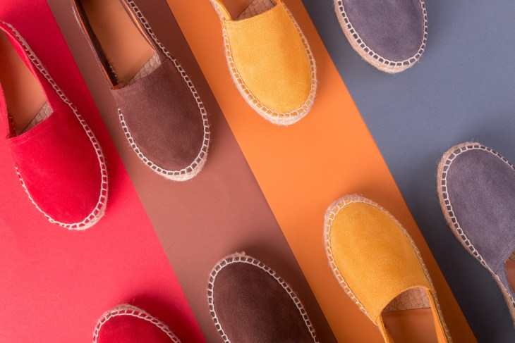4 pairs of espadrilles on a multicolored background