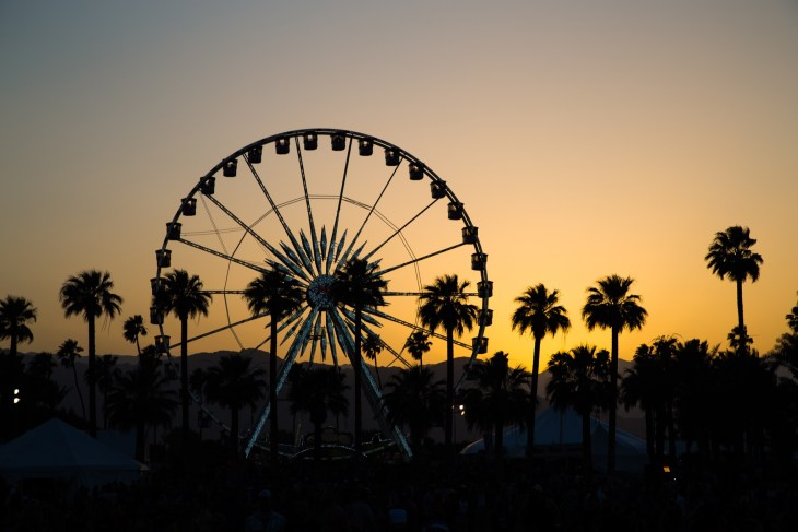 Ferris Wheel and Palm Tree Silhouette at Sunset in California
