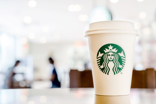 Starbucks Hot beverage coffee on table on 22 August 2014 at The mall department store, Bangkok, Thailand.