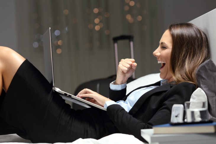 Excited bussinesswoman during a business travel finding online content