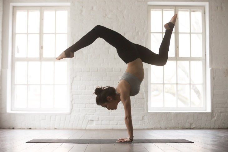 Woman practicing Yoga in a handstand