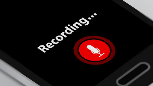 black screen recording... in white letters red button with white microphone symbol on it