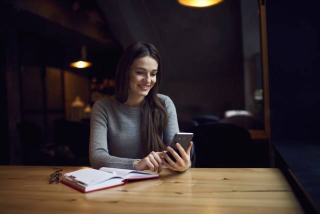 Smiling woman checking email box