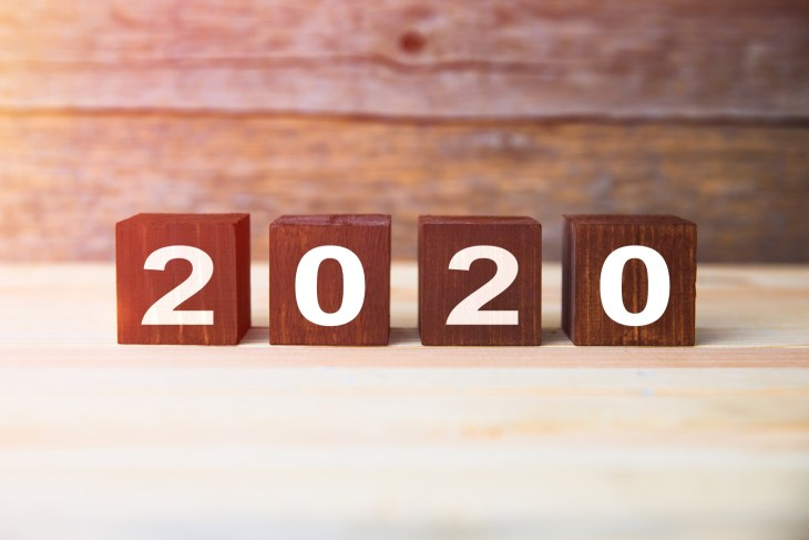 The year 2020 on wooden numbered cubes.