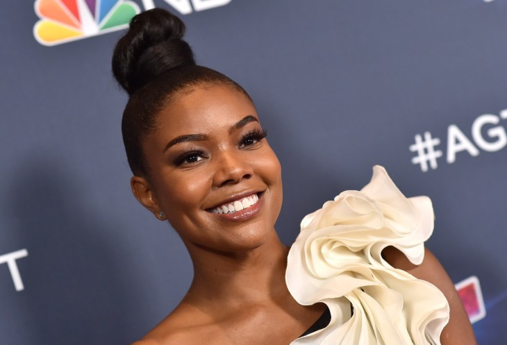 Gabrielle Union smiling on the red carpet of AGT.