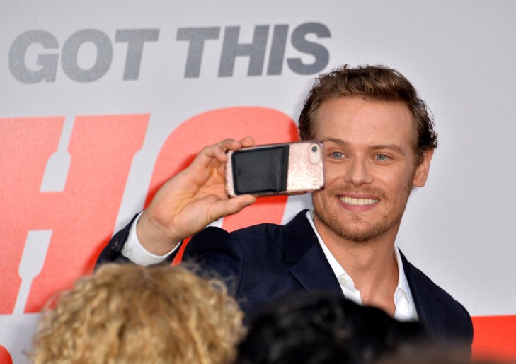 Sam Heughan Smiling, Taking Picture With Fans