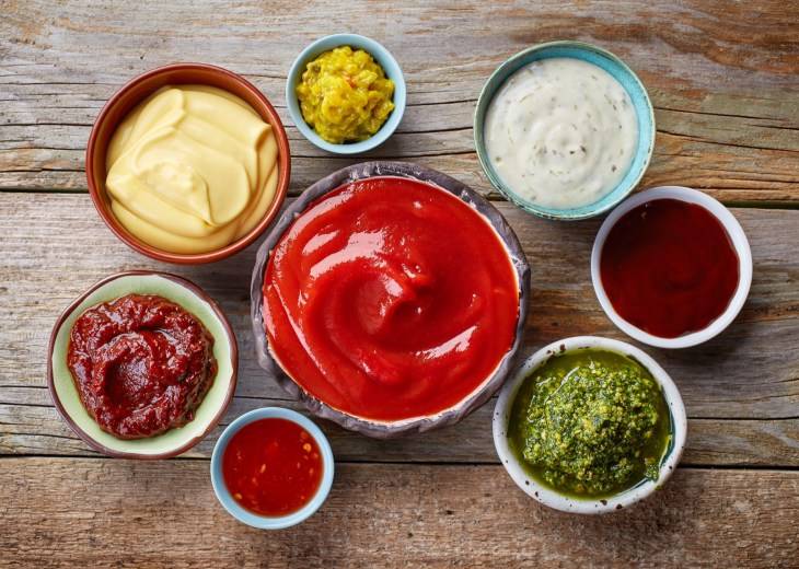 Many condiments served in small bowls.