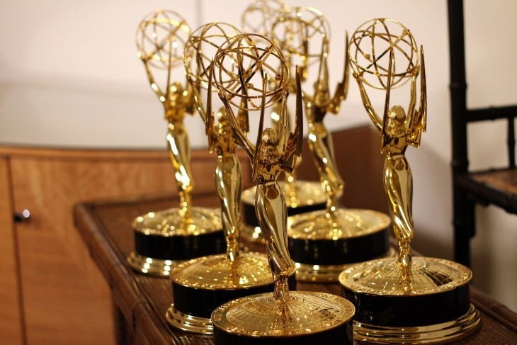 Several Emmy statues on a table