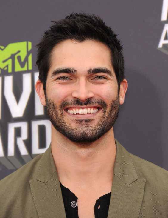 Photo of Tyler Hoechlin with beard in front of grey MTV Movie Awards background.