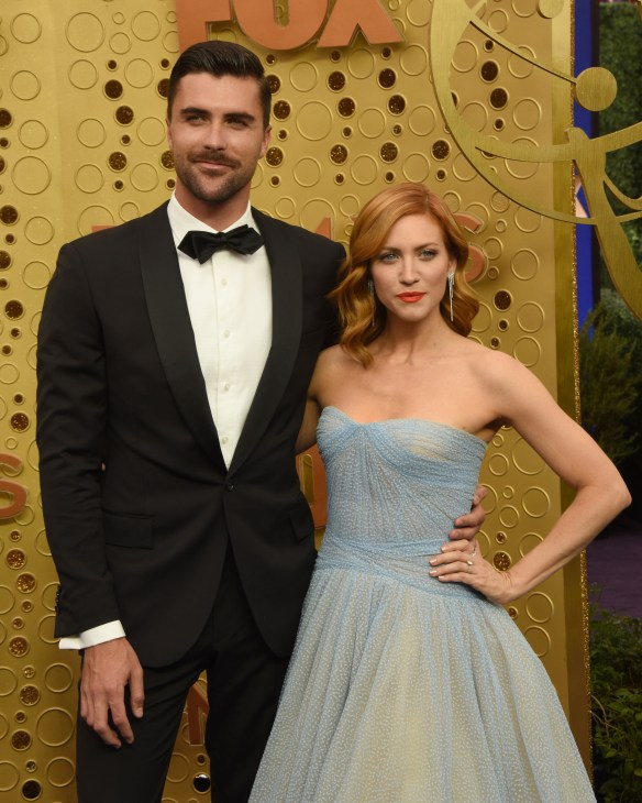 Photo of Brittany Snow and Tyler Stanaland from the Emmys. She is in a blue strapless dress and he is in a black tuxedo.