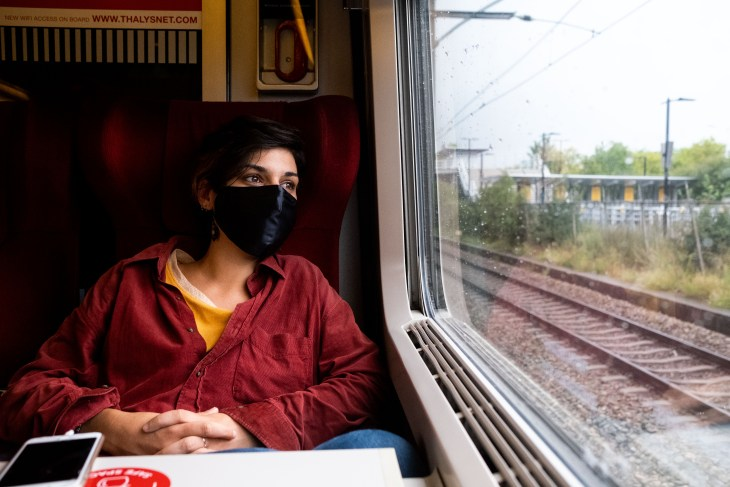 Woman On Train With Silk Face Mask