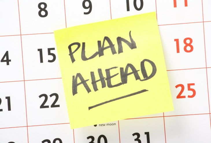 A calendar with a post it note that says plan ahead.