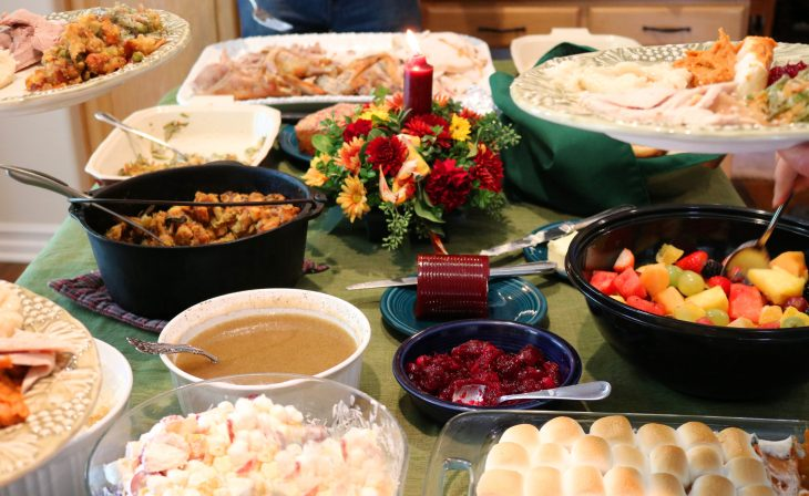 A holiday table with food dishes all on it.
