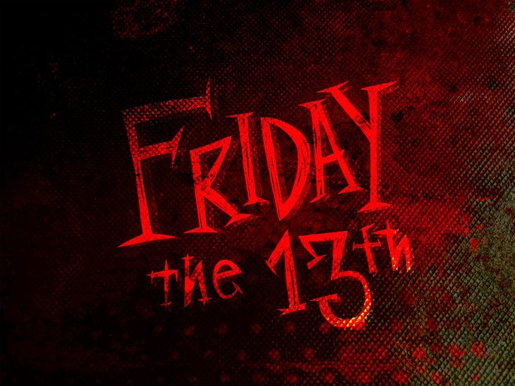 Friday the 13th is written in red letters in different shapes and sizes. The background is mesh between the colors black, red, orange, and green.