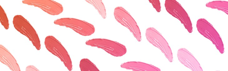 A variety of pinkish lipstick swatches on a white background