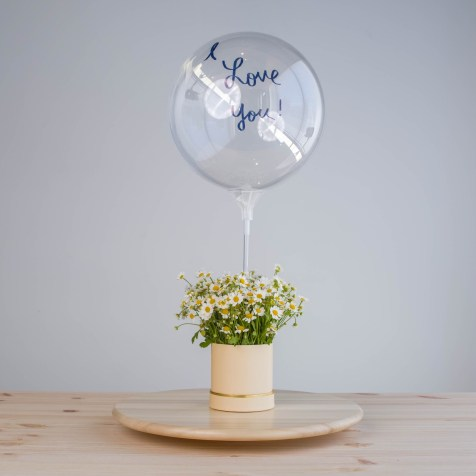 Flowers with I love you balloon.