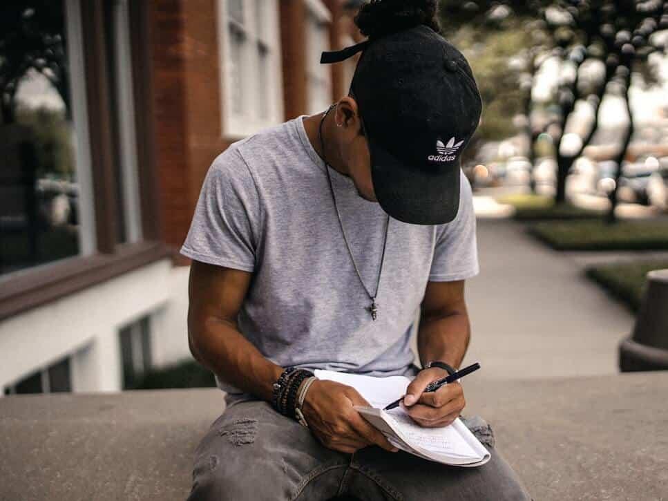 man sitting to take notes
