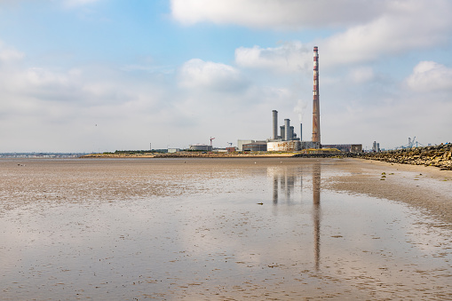Power plant in Dublin port and Poolbeg beach, Dublin, Ireland