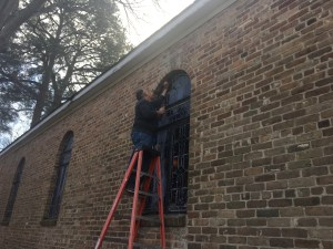 Stained glass windows being installed in Howard Chapel.
