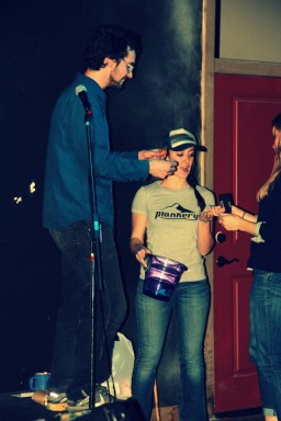 Augie, owner of the Crankery, and Claire Powell conduct the raffle.