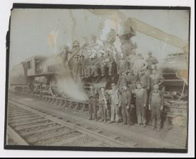 railroad workers gathered in front of an engine c 1910 cwhs