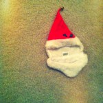 Day 17: On the Floor. Lonely Santa hat sans kitty.
