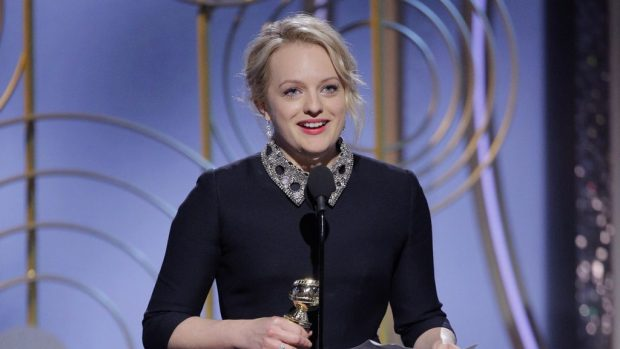 "BEVERLY HILLS, CA - JANUARY 07: In this handout photo provided by NBCUniversal, Elisabeth Moss accepts the award for Best Performance by an Actress in a Television Series – Drama for ""The Handmaid's Tale"" speaks onstage during the 75th Annual Golden Globe Awards at The Beverly Hilton Hotel on January 7, 2018 in Beverly Hills, California. (Photo by Paul Drinkwater/NBCUniversal via Getty Images)"