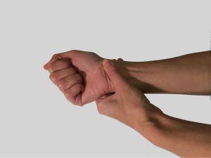 rubbing wrists