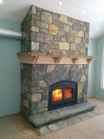 Elite Blue Granite & Harvest Gold Limestone Tumbled Random Blend Fireplace side view