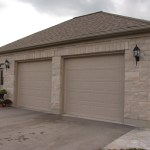 brown limestone ledgerock house weathered garage
