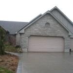 charcoal limestone tigerstripe tumbled legerock house garage