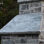 elite blue granite outdoor fireplace side detail
