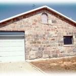 split fieldstone squared garage front