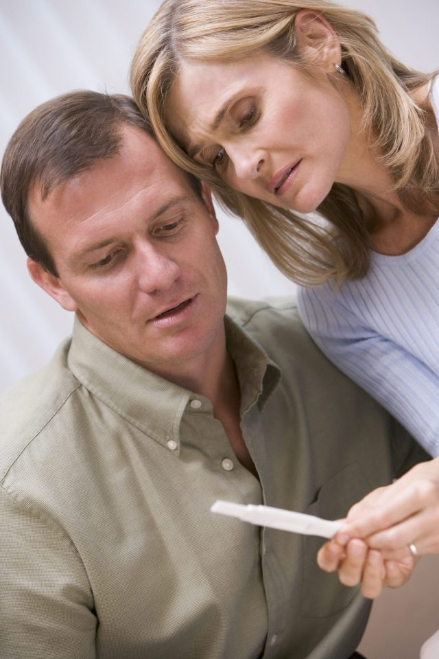 couple-looking-at-negative-home-pregnancy-test_BKSoH2ABo (1).jpg