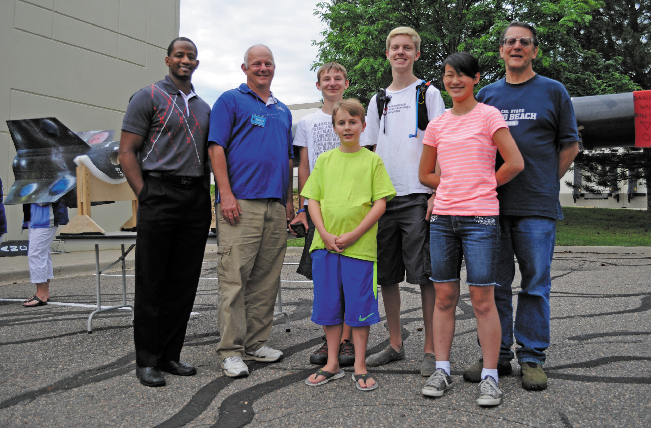 Students from STEM School and Academy in Highlands Ranch built a payload that was launched on a 25-foot ULA rocket in Pueblo on July 18. From left to right are, ULA mentor Taheem Williams, Bryon Paul Veal of APRL,  STEM students  Alex Gentilucci (front), Gunnar Enserro, Grayson Gerlich and Ari Martinez and instructor/former ULA engineer Jeff Dunker.