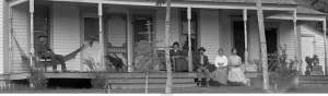 Allen Zerbe sitting on his ranch porch with friends and family