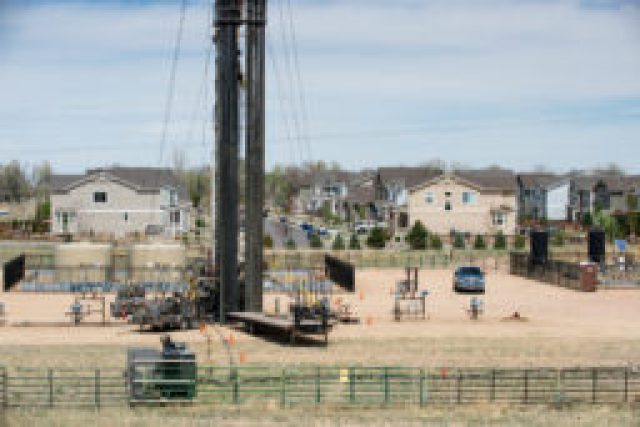 Oil and gas development in the heart of Erie, Colorado, next to the town skate park, baseball fields, library and homes. (Photo by Ted Wood/The Story Group.)