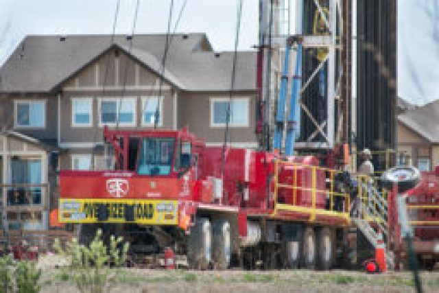 Oil and gas development in new housing subdivision on Collier's Hill. (Photo by Ted Wood/The Story Group.)