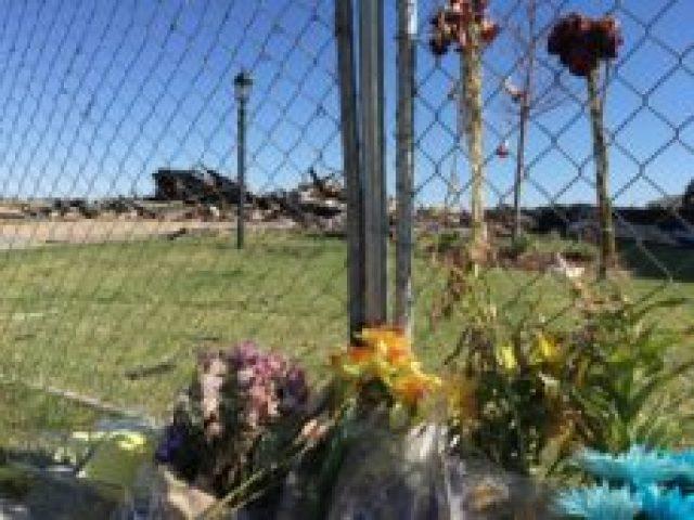 Flowers near the site of the fatal home explosion on Twilight Avenue in Firestone. (Photo by Tina Griego).