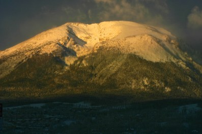 Intense morning alpenglow on the face of Buffalo Mountain, above Silverthorne, Colorado.