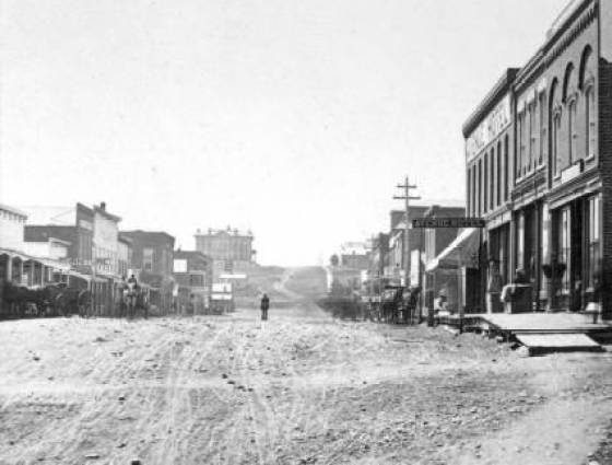 Golden City - Washington Avenue, main street, shows two-story brick blocks and wood frame false front buildings, 1878-1880