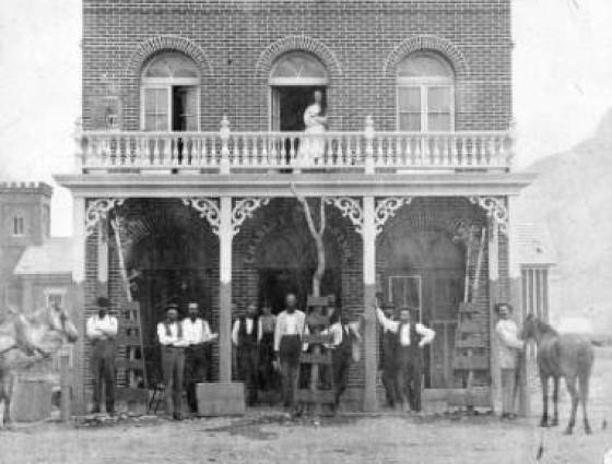Golden City - men pose on the boardwalk of Charley Garbarino's City Restaurant at 1211 Washington Ave., 1870-1880