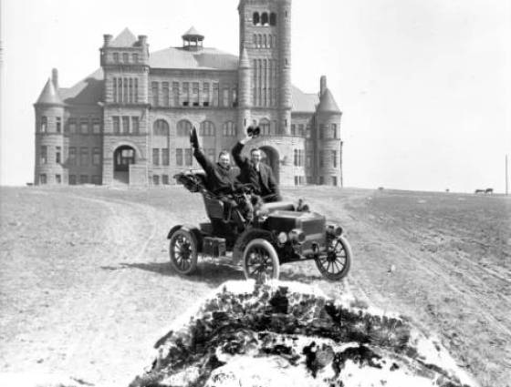 Westminster - Westminster College at 3455 West 83rd Avenue, with Harry M. Rhoads behind the steering wheel, 1895
